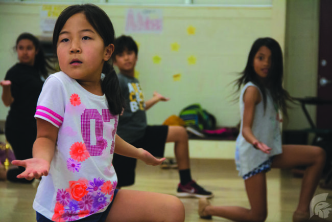 "Katie Hashimoto | Trojan  Times Maya Nakamoto (second grade), sea creature ensemble, is one of many young children who are a part of the cast. In this all ages musical, all actors have been practicing for the debut of ""The Little Mermaid"" musical on March 17."