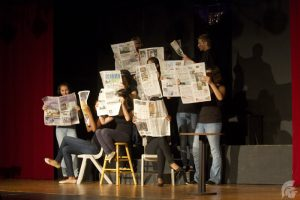 "(Harlan Rose | Trojan Times) ""Between the Lines"" is a drama by Dennis Bush that discusses the pitfalls of unreliable journalism. As the play had many minor parts, the majority of the actors involved took on multiple roles."